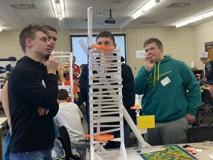Students looking at paper roller coaster